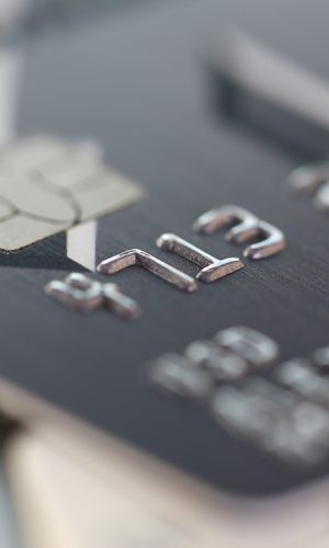 Stock image of a black credit card on a keyboard