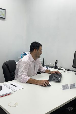 Image of Peter Ribet sitting at his desk in the office of P.Ribet Taxation & Accounting